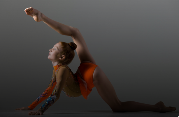 A young dancer at Capital City Dance doing Acro Dance
