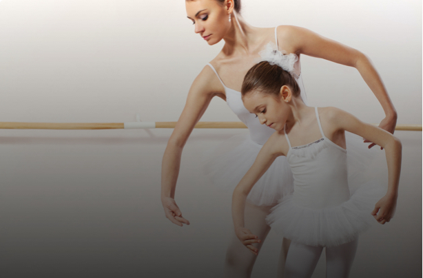 A ballet instructor teaches a young student at Capital City Dance