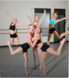 Competitive dancers at capital city dance pose togetherb