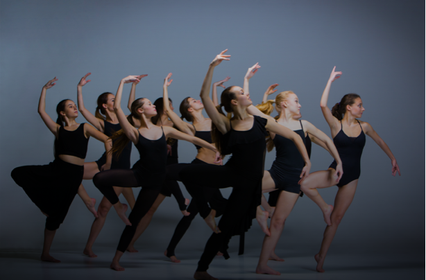 Contemporary dancers performing at Capital City Dance's studio
