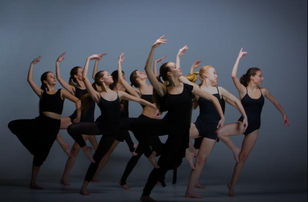 Contemporary dancers performing at Capital City Dance's studio