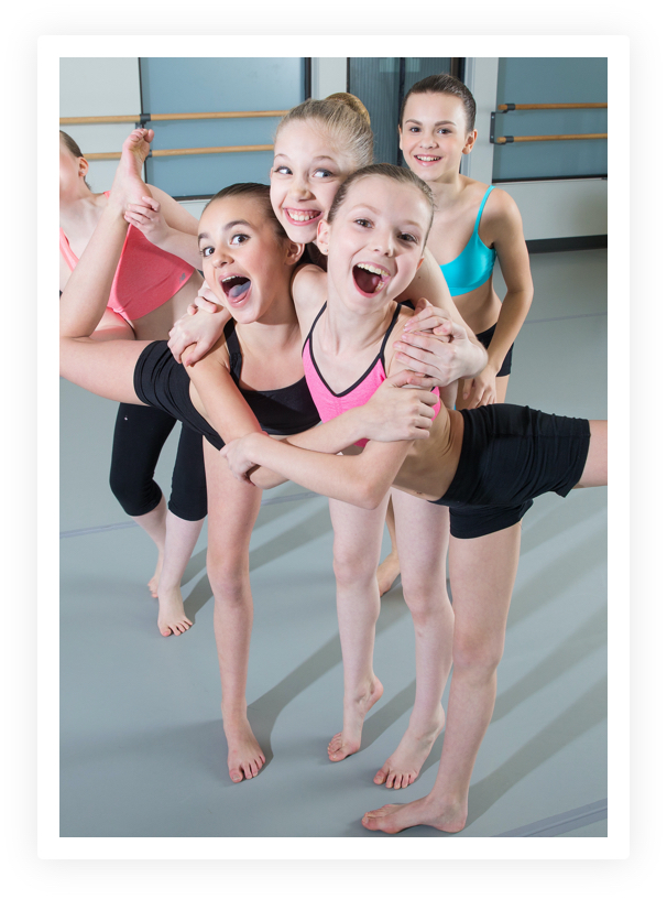 Young dancers smile and pose together at capital city dance