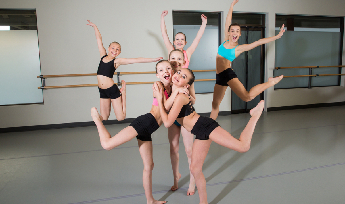 A dance class poses together at Capital City Dance