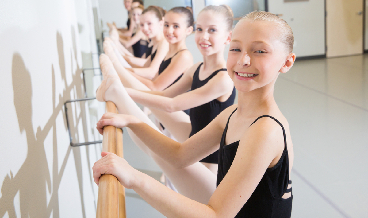 A young ballet class does barre work at Capital City Dance