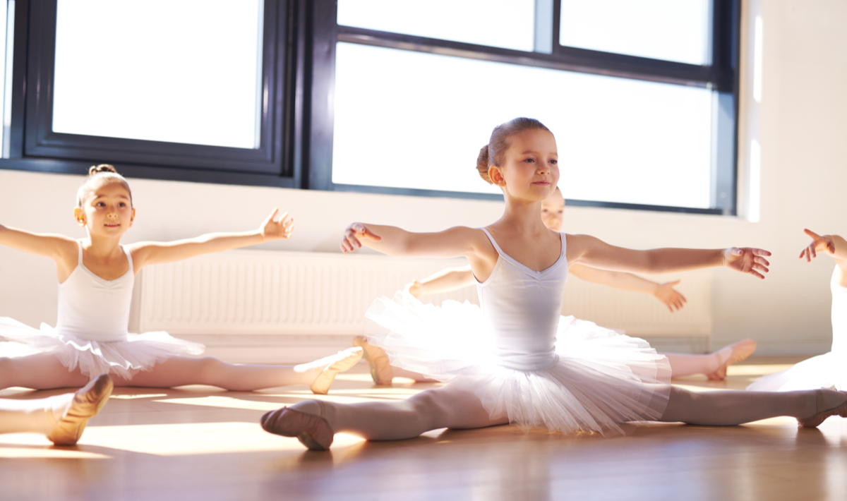 Young ballet dancers do exercises at capital city dance
