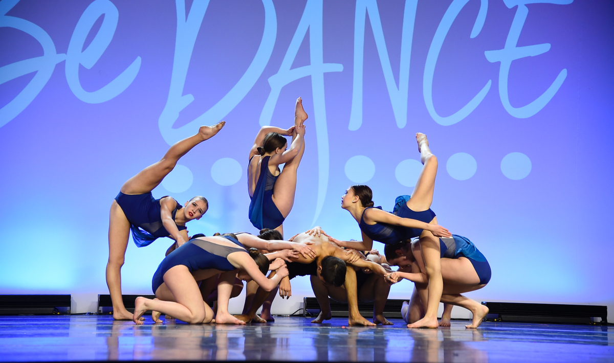 A Capital City contemporary Dance Team performs together on stage