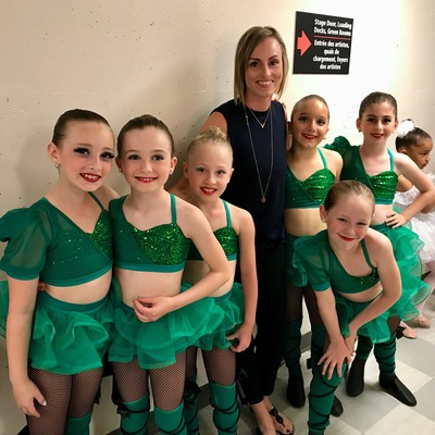 Jazz dancers backstage before performing at capital city dance